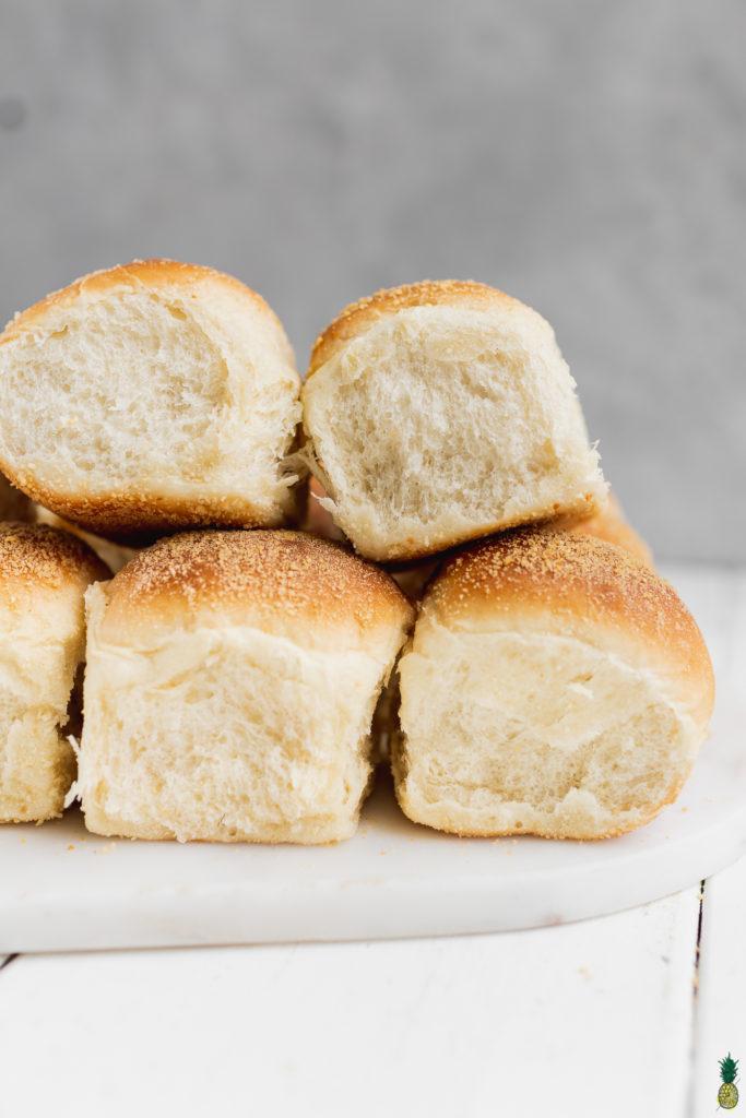 Vegan filipino pandesal bread rolls stacked by Sweet Simple Vegan