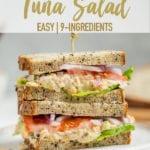 Vegan chickpea tuna salad sandwich on a plate and cut on the Sweet Simple Vegan Blog Pinterest