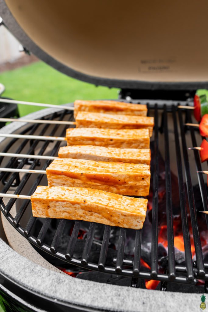 barbecue tofu skewers on grill side angle