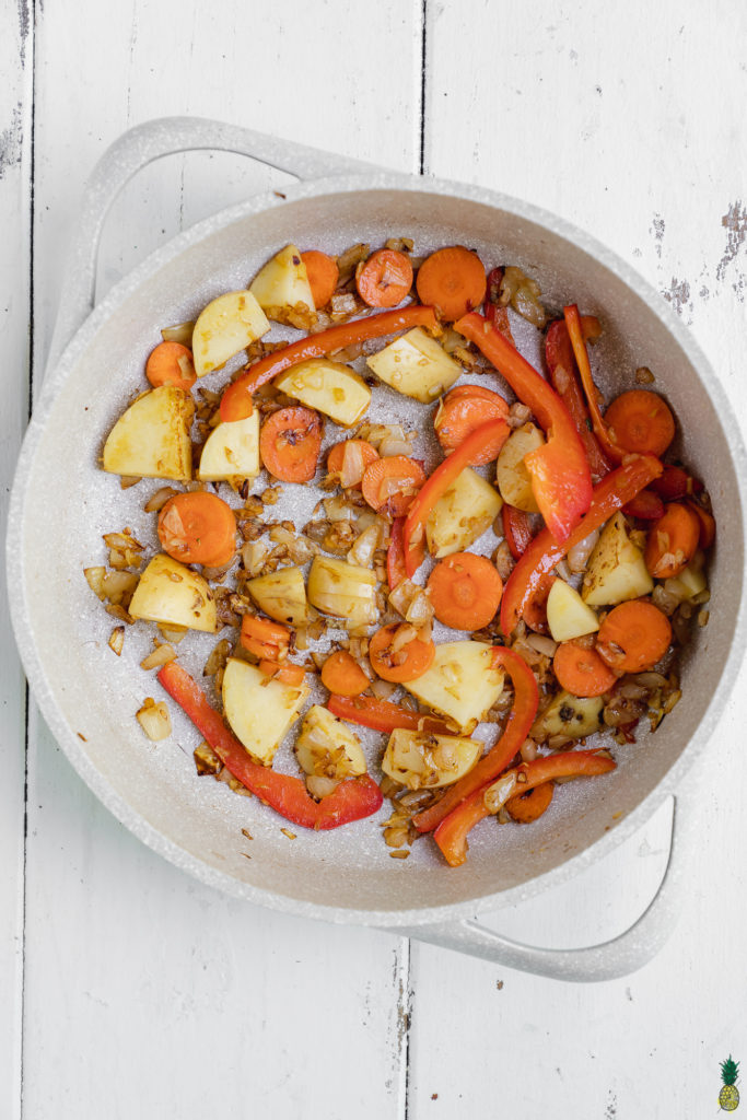 Vegetables cooked in a non stick pan for Thai green curry by Sweet Simple Vegan.