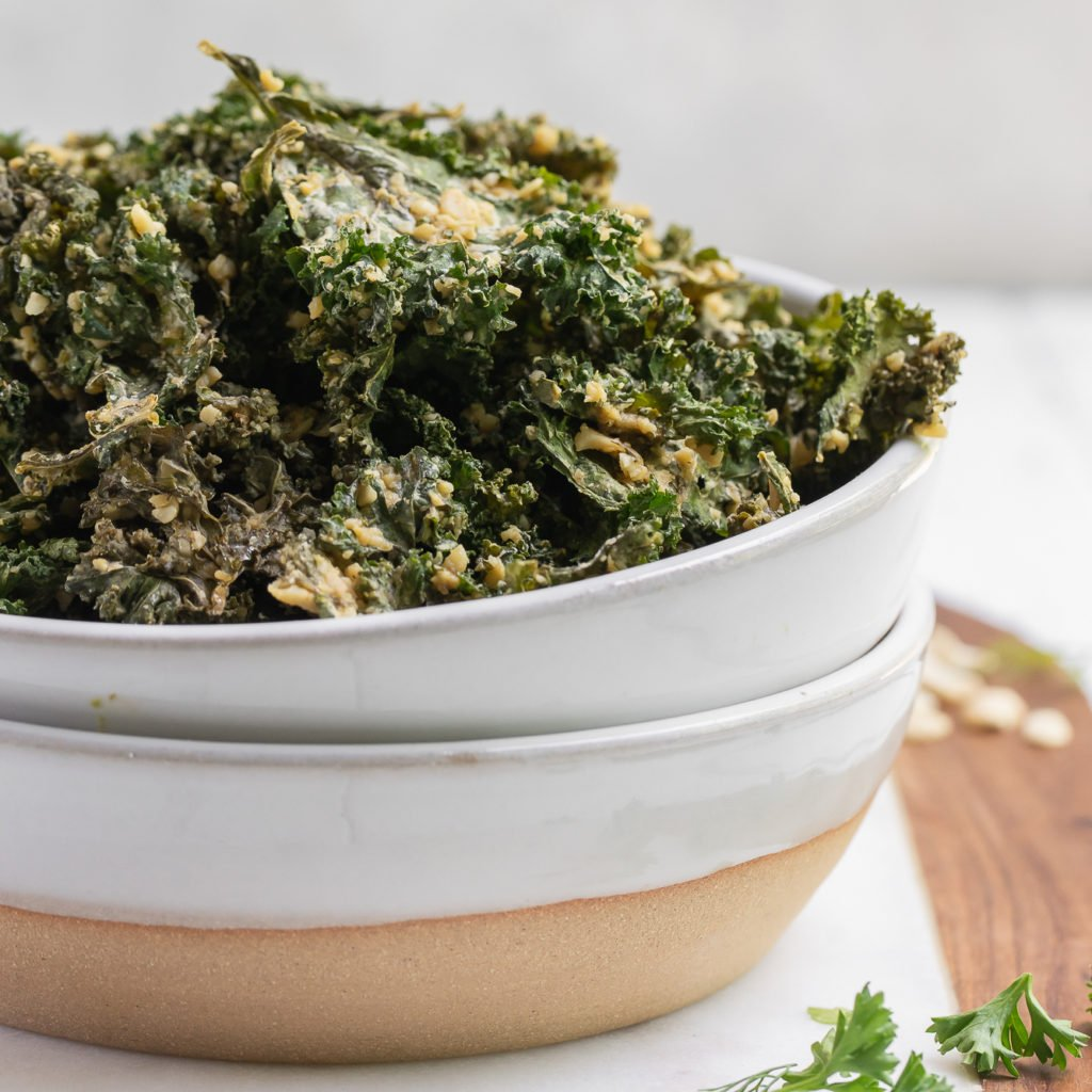 Baked Vegan Ranch Kale Chips up close in a bowl by sweet simple vegan