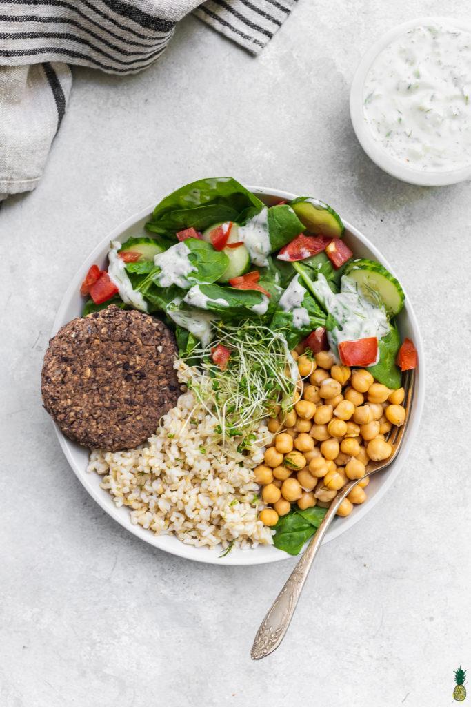 5 ingredient veggie burger served with rice and vegetables by sweet simple vegan