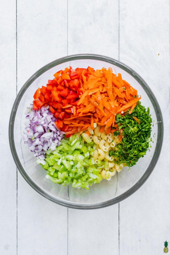 rainbow vegetables in a bowl making a vegan macaroni salad by sweet simple vegan