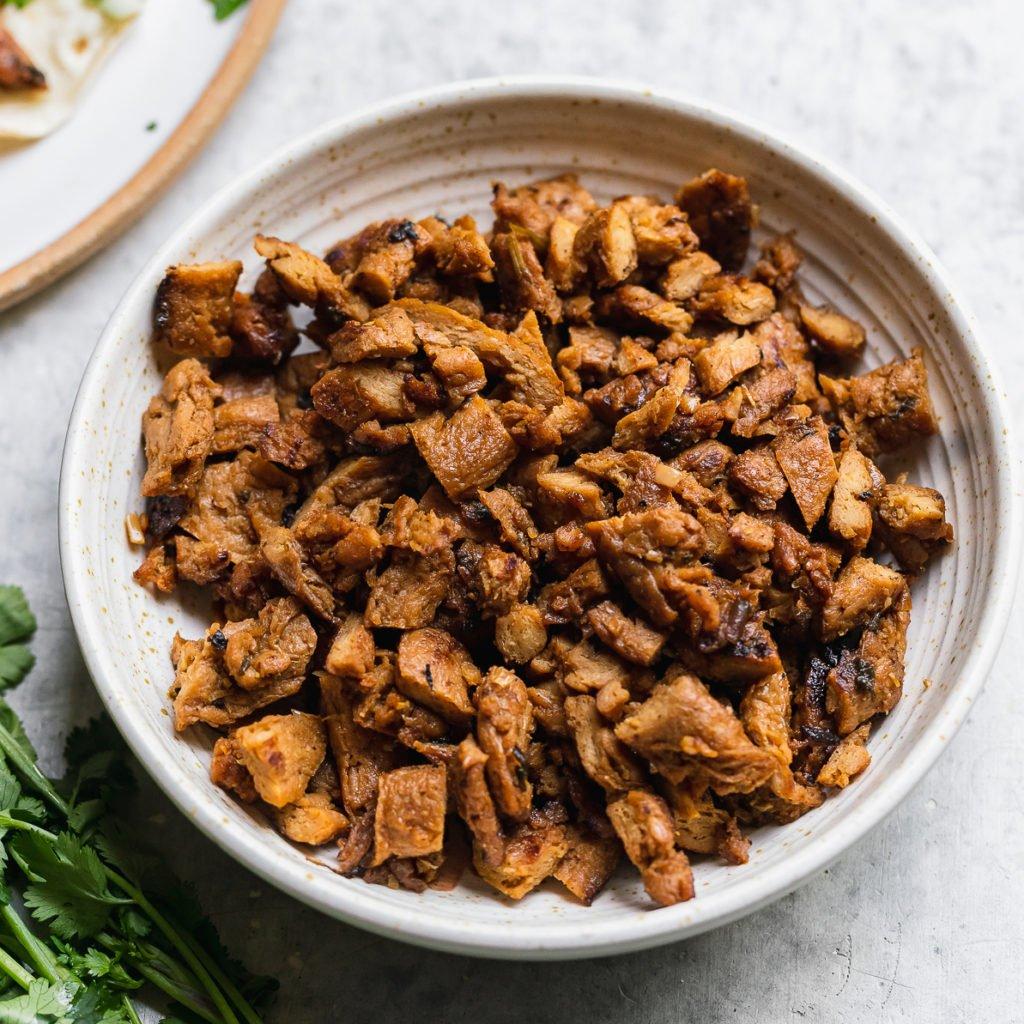 Closeup shot of chopped vegan carne asada taco meat by sweet simple vegan