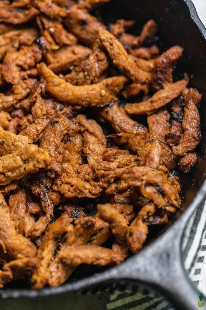 Closeup shot of vegan carne asada taco meat by sweet simple vegan