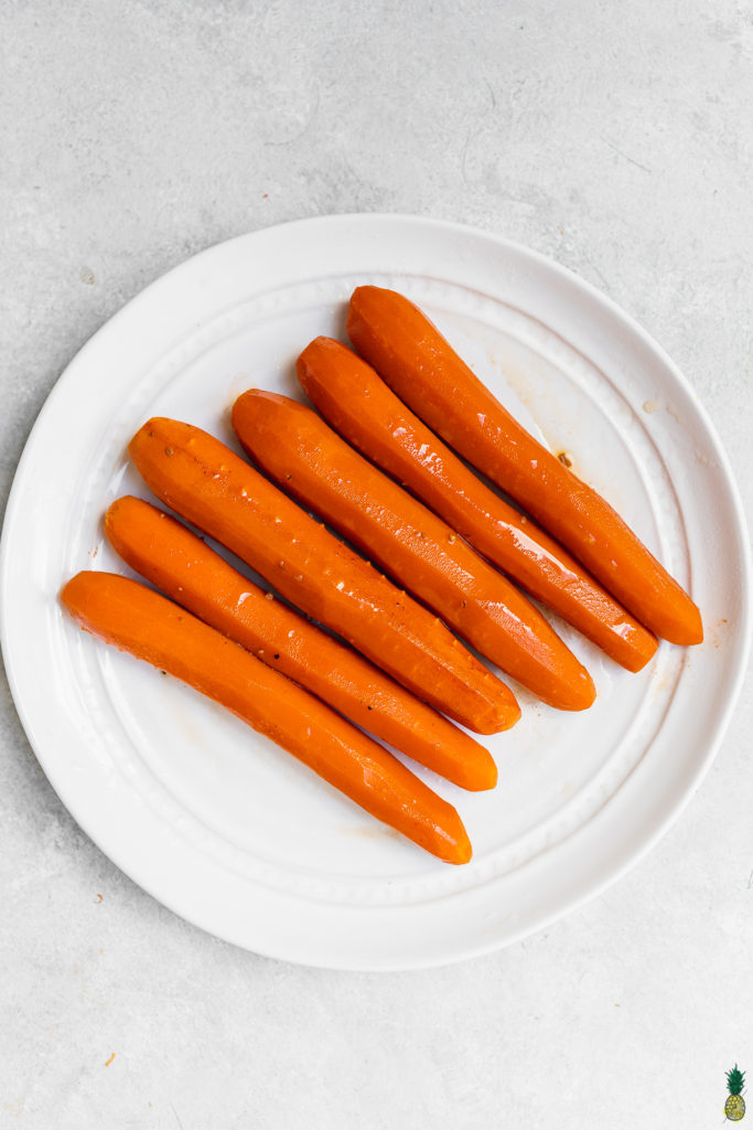 Carrot hot dogs cooked and glazed, ready to be served.