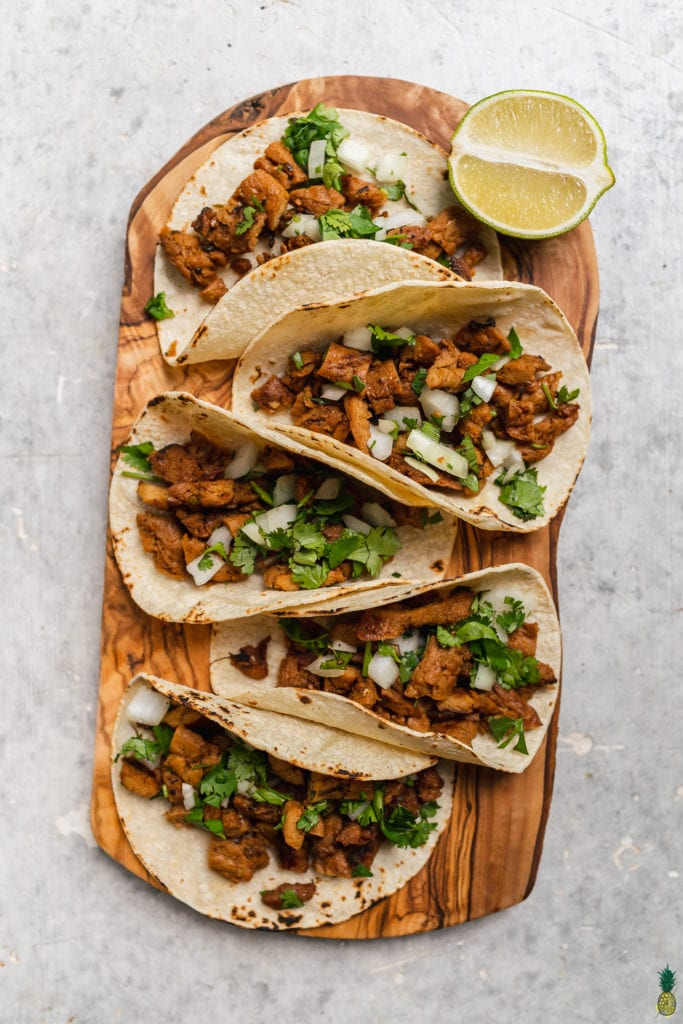 Vegan carne asada tacos with cilantro and onions by Sweet Simple Vegan