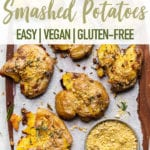 Crispy garlic and herb smashed potatoes with ketchup and vegan parmesan for pinterest