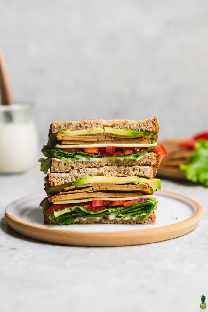 homemade vegan deli slices on a sandwich food photography by sweet simple vegan