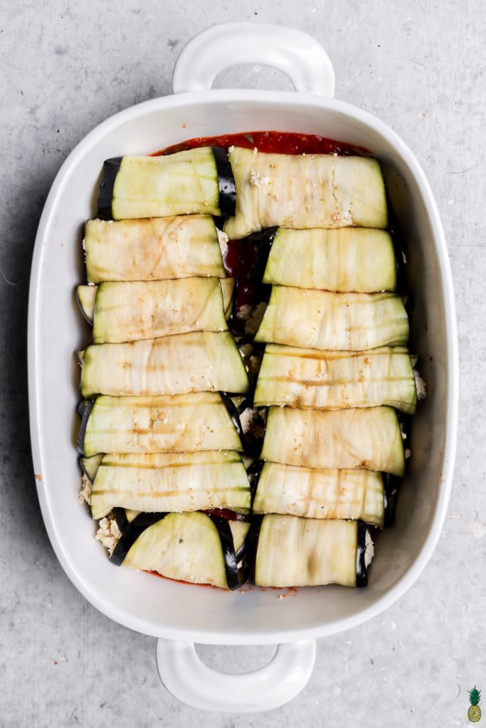 Step by step overhead image of eggplant rollatini in a baking dish with no cheese or sauce