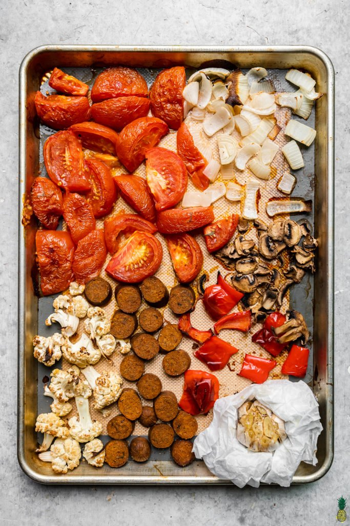 ingredients on a sheet pan to make an easy vegan sheet pan pasta recipe by sweet simple vegan