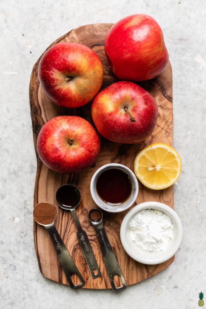 Ingredients for vegan apple crisp on a wooden board by sweet simple vegan