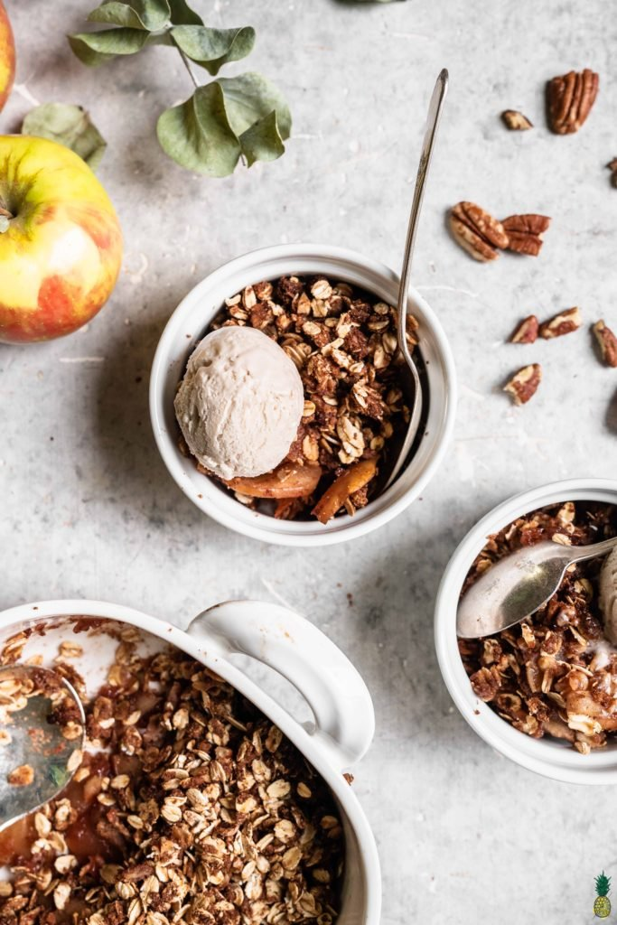 Bowls with vegan apple crisp and vanilla ice cream