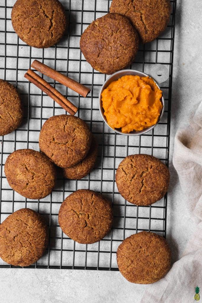 vegan gluten free pumpkin snickerdoodles on a cooling rack