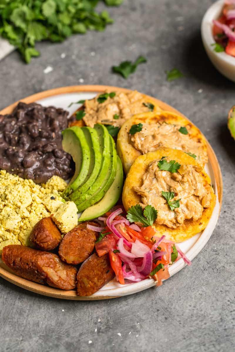 a close up of a plate of vegan Ecuadorian breakfast