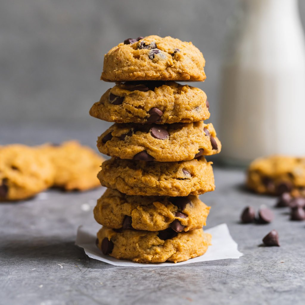 a stack of cookies; vegan pumpkin chocolate chip cookies