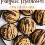 Chocolate Dipped Pumpkin Macaroons on a white marble plate for pinterest