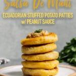 Vegan llapingacho ecuadorian potato patties stacked with peanut sauce for pinterest