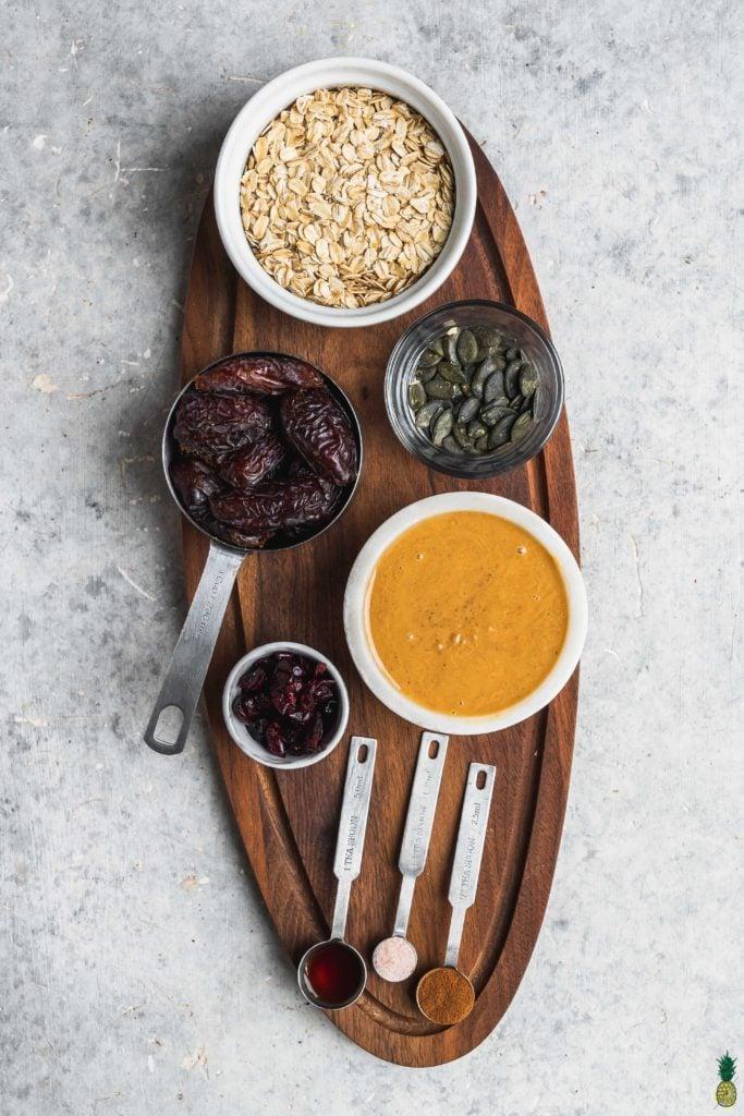 ingredients for no bake peanut butter breakfast bars on a wooden board