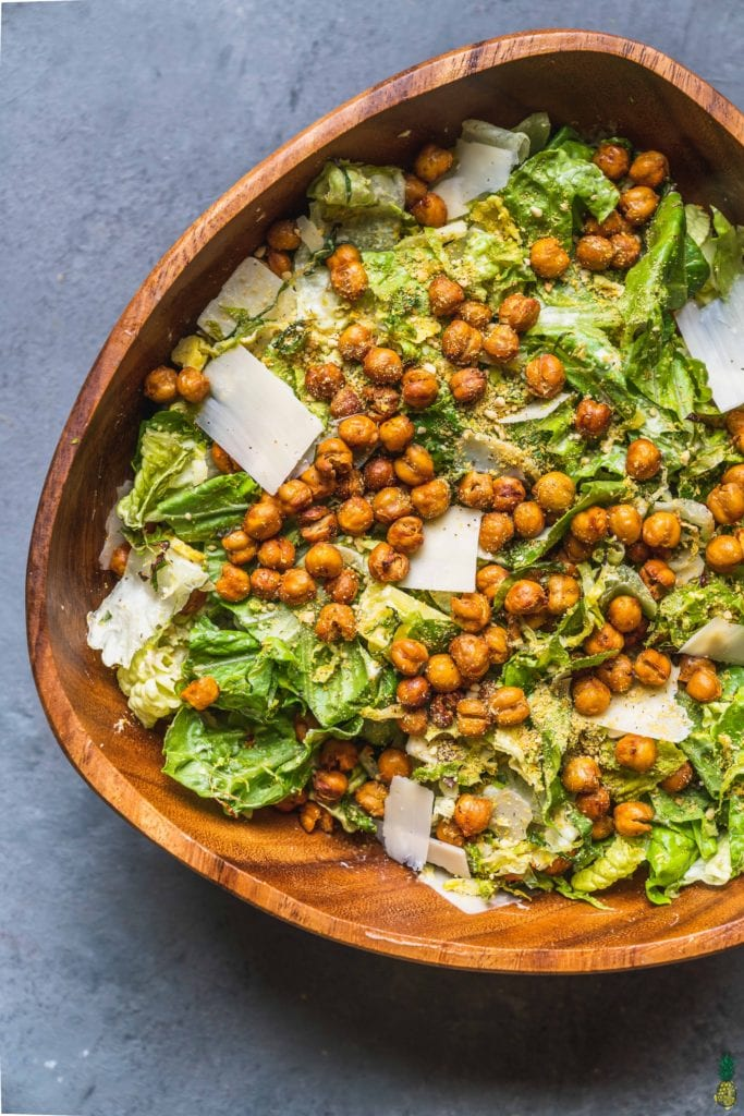 over head of brussels sprouts caesar salad in large wooden bowl