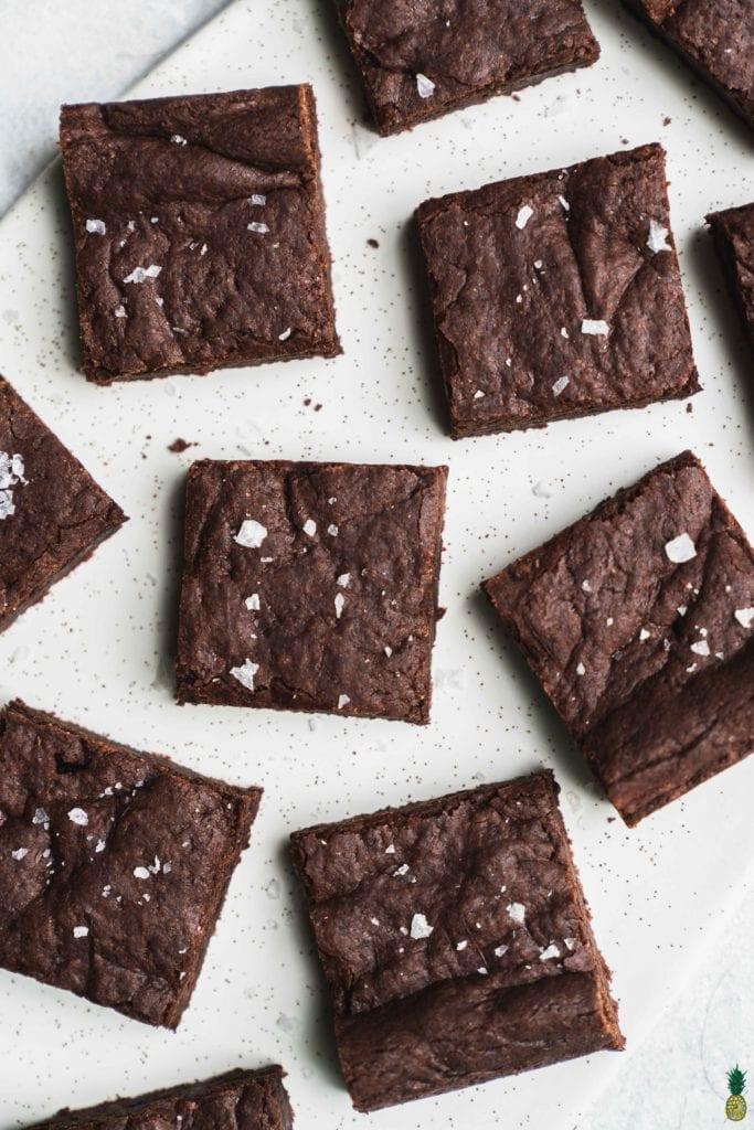 Christmas Recipe - vegan brownies with maldon salt on a marble platter by sweet simple vegan
