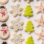 An overhead shot of colorful christmas cookies on a marble board; food photography