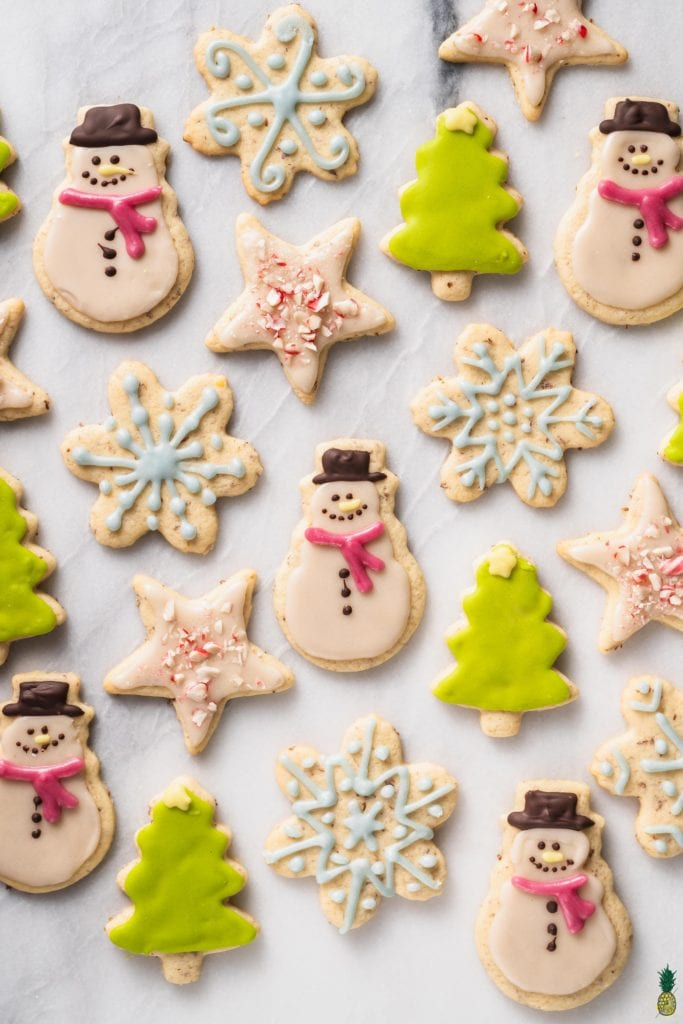 Christmas Recipe - An overhead shot of colorful christmas cookies on a marble board; food photography