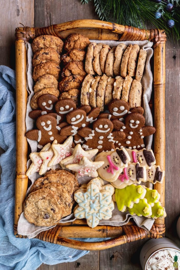 A platter of vegan christmas cookies with shortbread, gingerbread, chocolate chip and sugar cookies