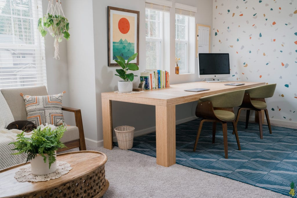 image of home office with desk, couch, and table.