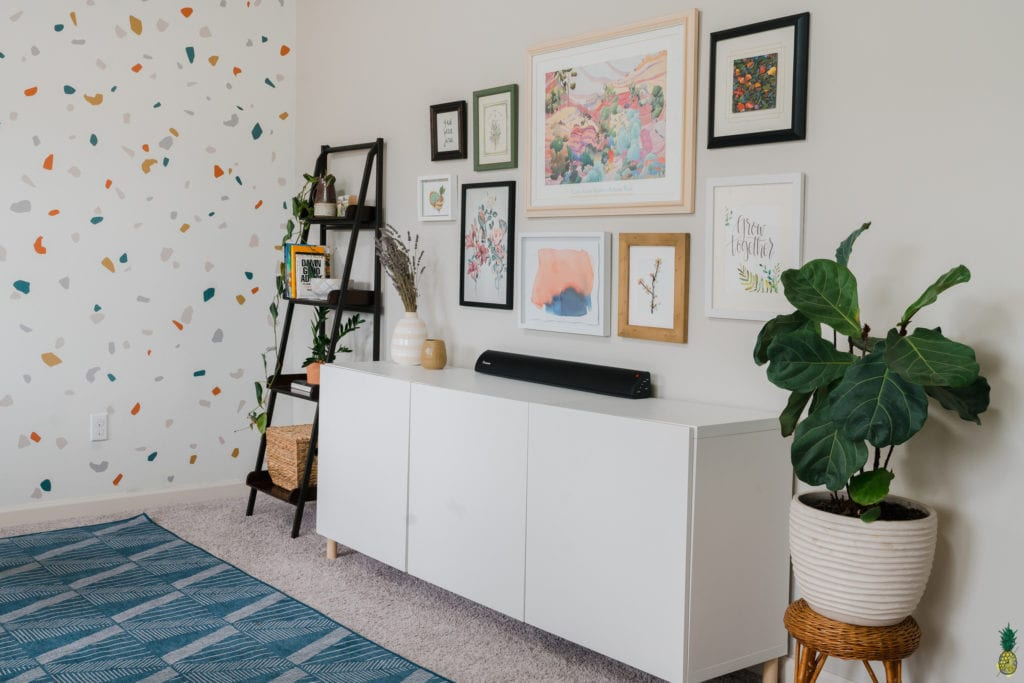 home office with cabinet and shelf with gallery wall.