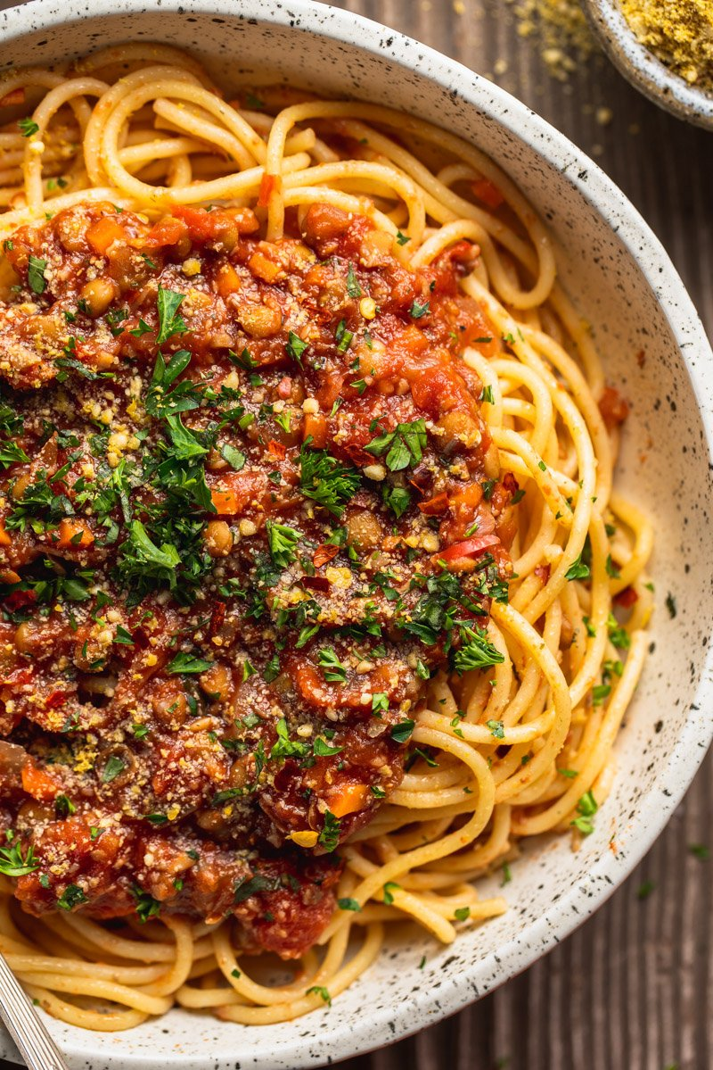 Close up of vegan bolognese Sauce on spaghetti in white bowl