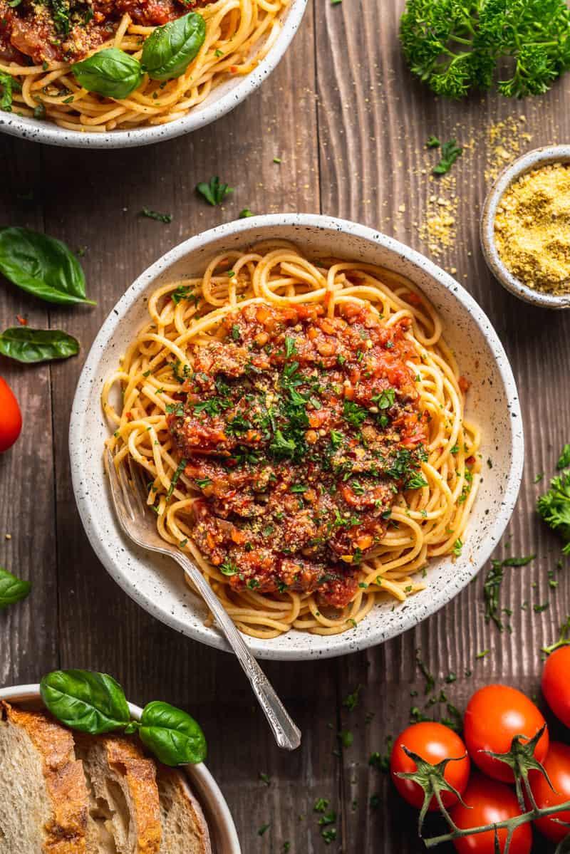 vegan lentil mushroom bolognese Sauce on spaghetti in white bowl