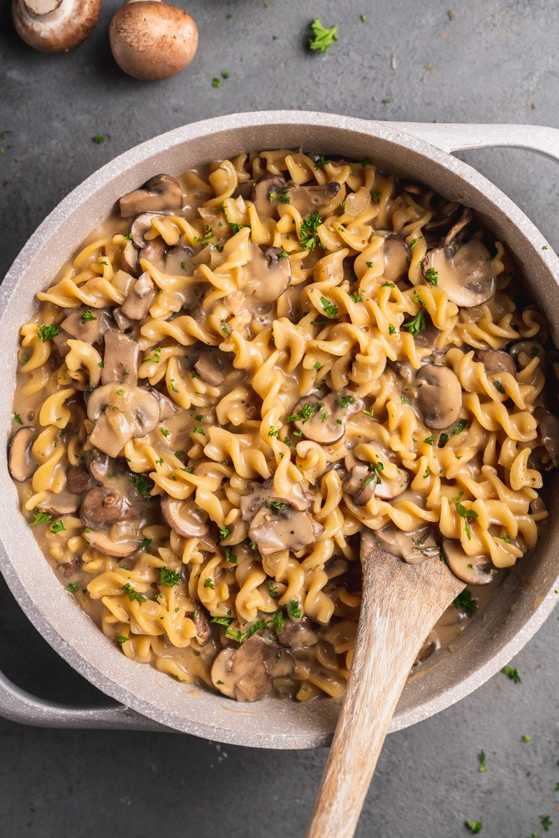 overhead image of stroganoff in large pot with done spoon.