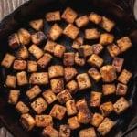 overhead ginger sesame tofu in cast iron skillet