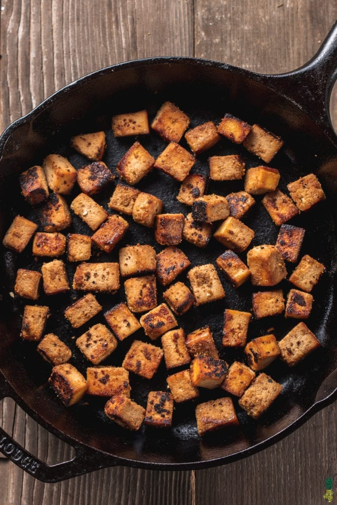 overhead image of ginger sesame tofu in a cast iron skillet