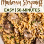 overhead close up image of mushroom stroganoff with wooden spoon for pinterest
