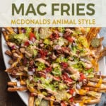 close up of Vegan Big Mac Fries (aka McDonald's Animal Style Fries) with a blue towel and beer for pinterest for pinterest