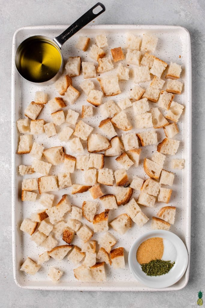 overhead image of easy 5-ingredient croutons on a sheet pan