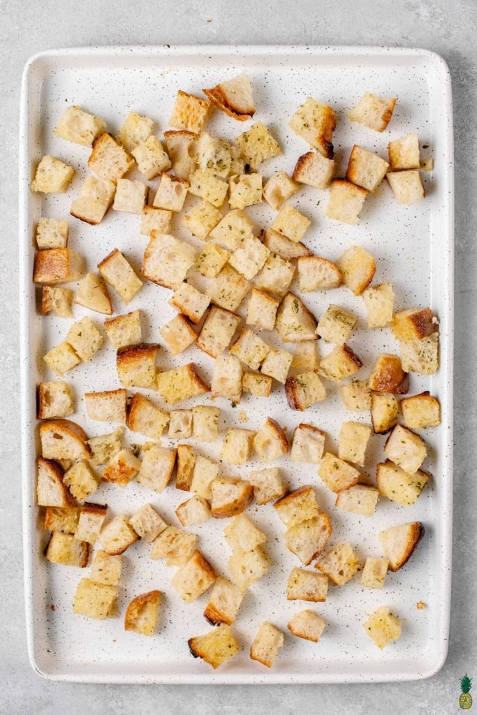 overhead image of diced bread on sheet pan