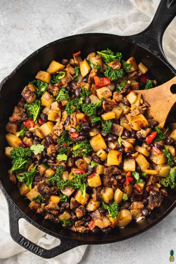 Vegan Breakfast Potato Hash in a cast iron skillet by sweet simple vegan