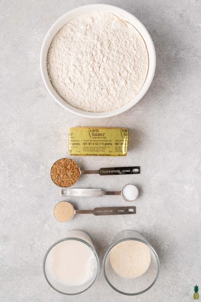 Ingredients to make vegan egg bread on a white background
