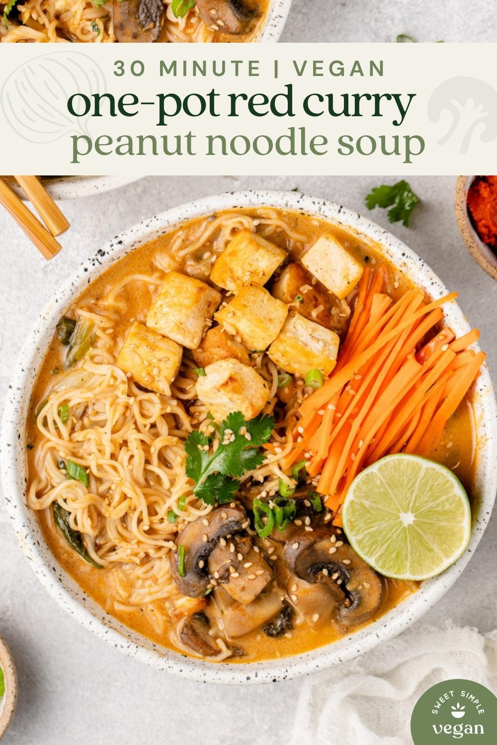 overhead macro image of red curry peanut noodle soup with text for pinterest