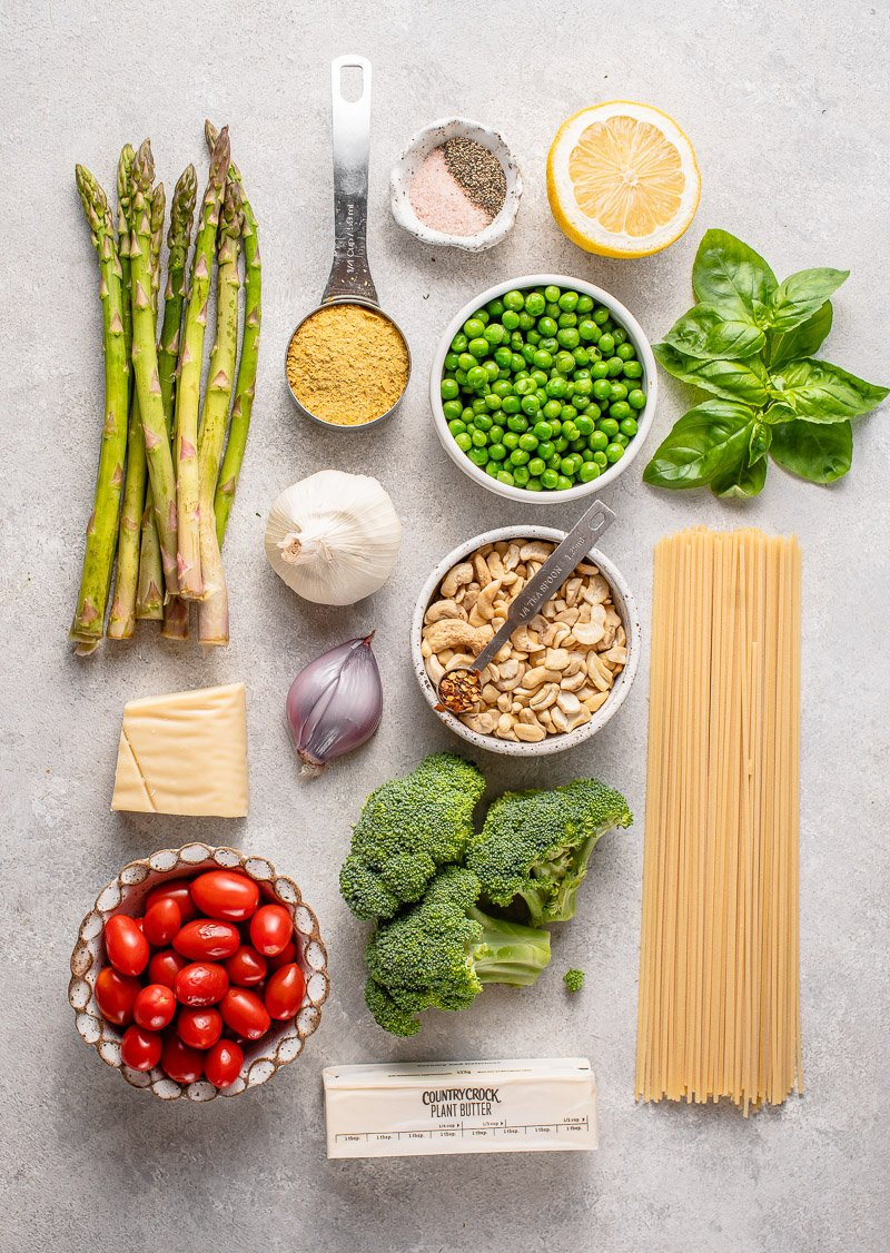 Overhead image of ingredients for vegan pasta primavera