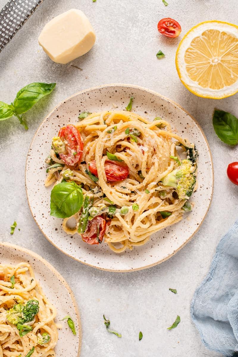 overhead image of pasta primavera on a white plate