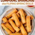 shot of Filipino Lumiang Shanghai in a white bowl with dipping sauces by sweet simple vegan for pinterest