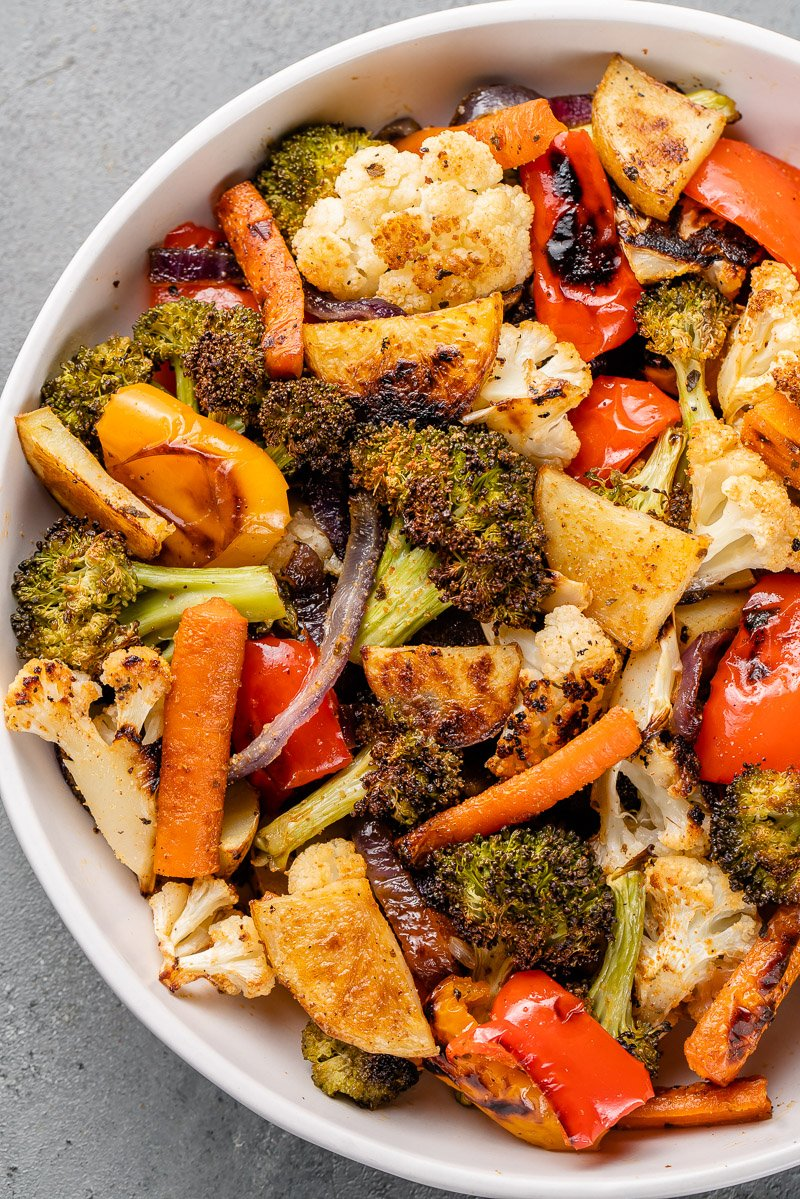 a close up of roasted vegetables in a white bowl