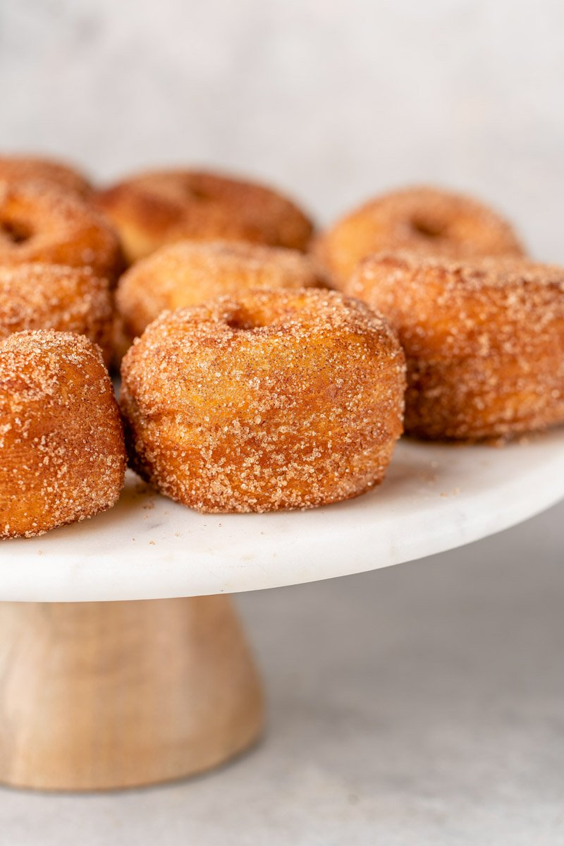 up close image of biscuit donuts on a stand
