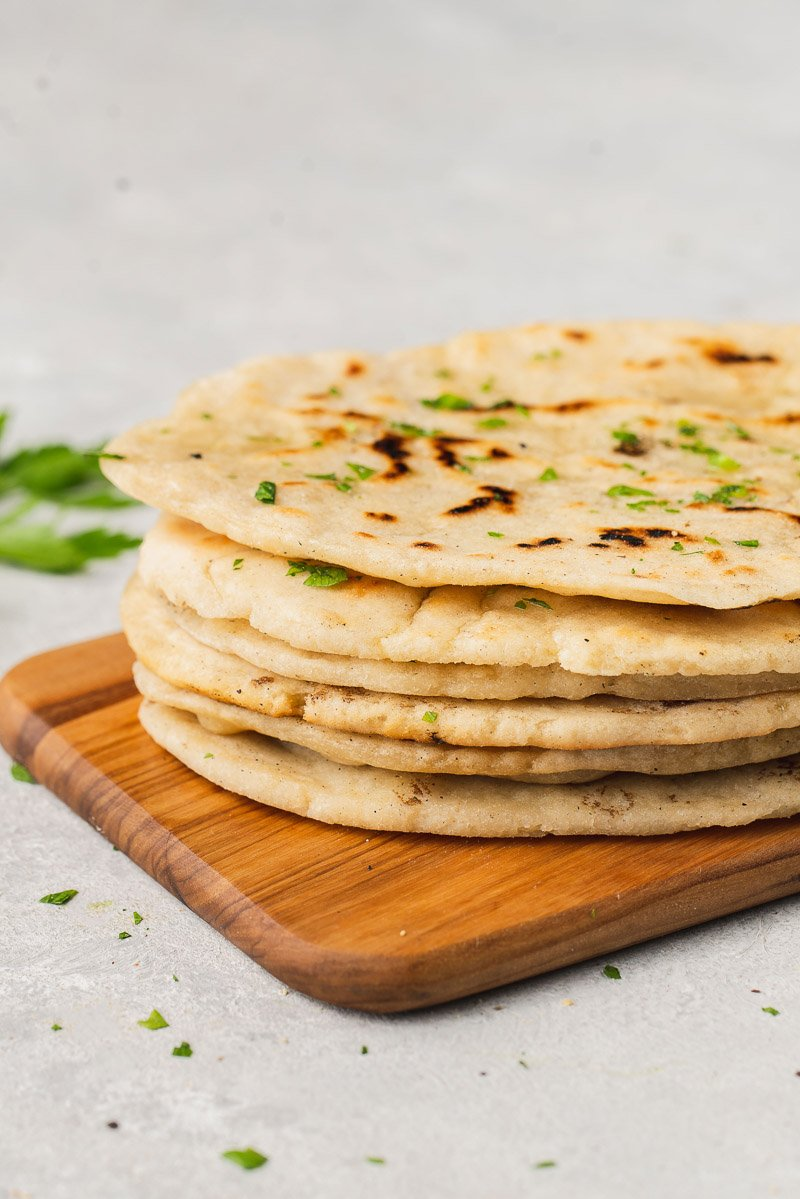 a close up shot of a stack of gluten free flatbread