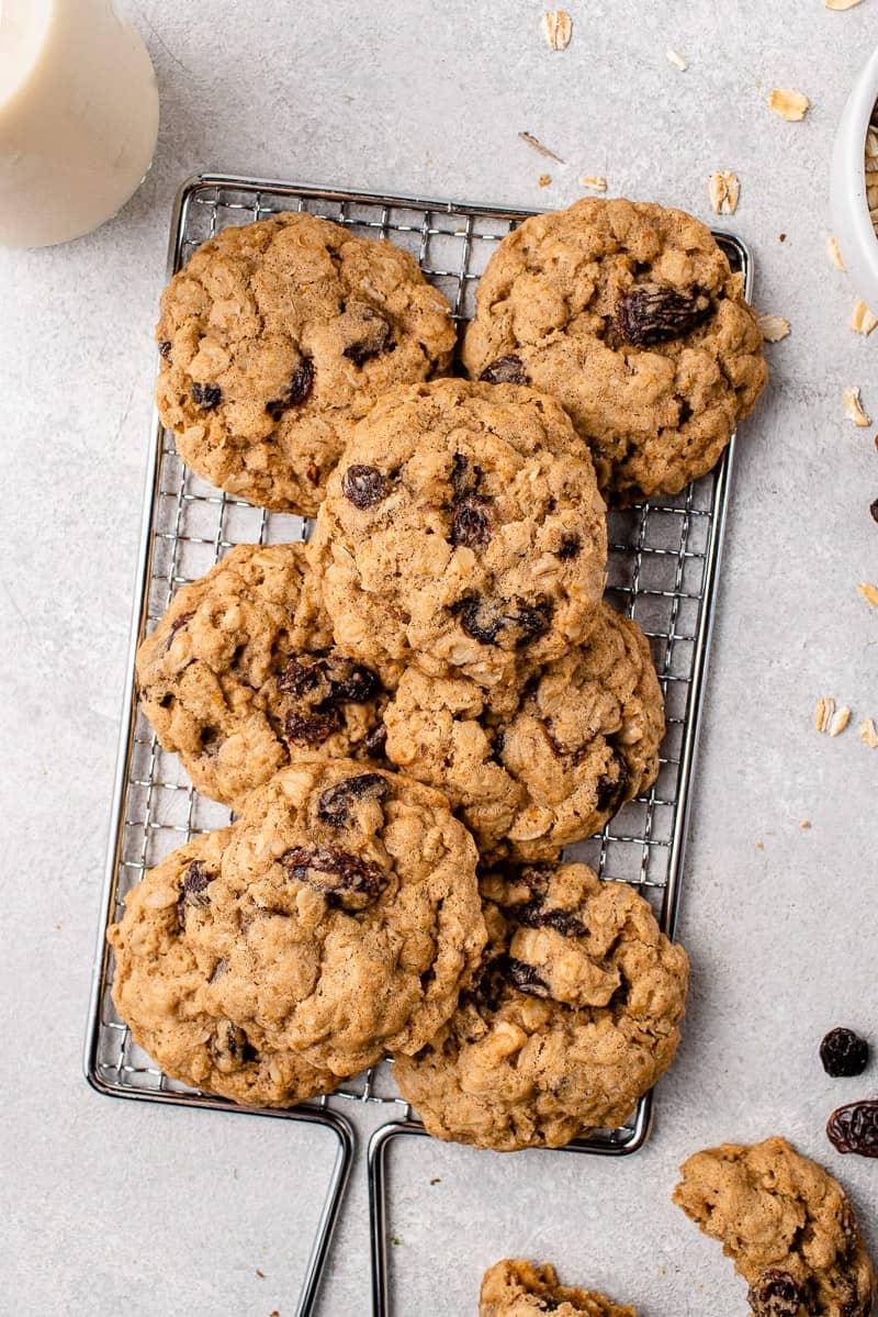 vegan oatmeal raisin cookies on a wire rack by sweet simple vegan