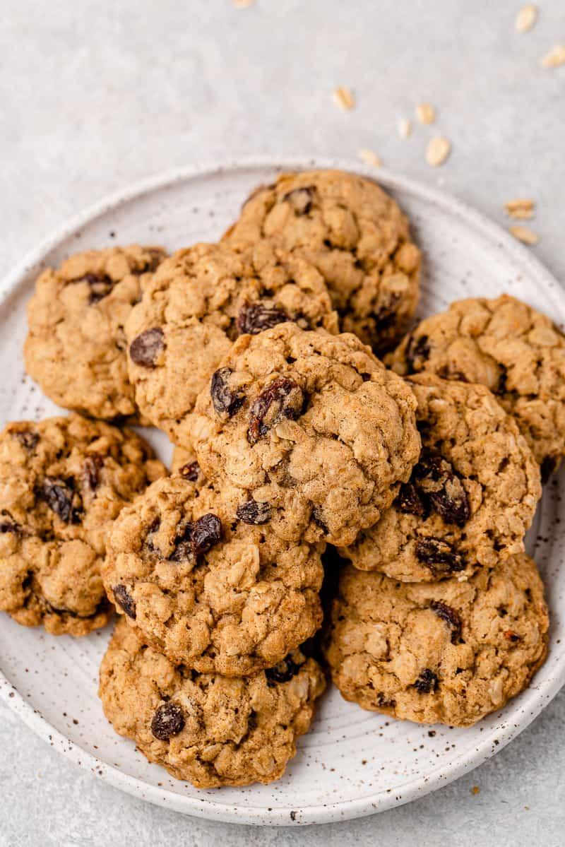 vegan oatmeal raisin cookies on a white plate by sweet simple vegan